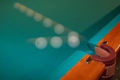 Billiard ball - motion. Billiard ball flying in a billiard pocket Stock Photography