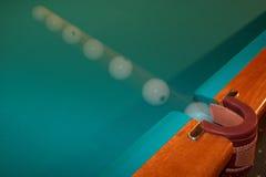 Billiard ball - motion. Billiard ball flying in a billiard pocket Royalty Free Stock Image