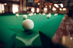 Billiard ball near pocket. One white billiard ball near the pocket focused Stock Photography