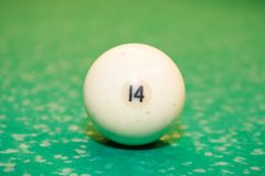 Billiard ball number 14. On the table Stock Photos
