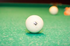 Billiard ball number 13. On the table Royalty Free Stock Photography