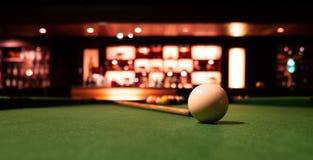 A billiard ball on a pool table. stock photos