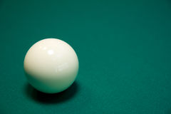 Billiard ball on a table. White billiard ball on a green table Royalty Free Stock Images
