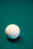 Billiard ball on a table. White billiard ball on a green table Royalty Free Stock Photos