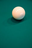 Billiard ball on a table. White billiard ball on a green table Stock Photos