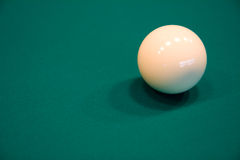 Billiard ball on a table. White billiard ball on a green table Stock Photo