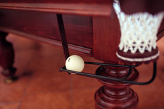 Billiard ball under the pool table in mesh.  Stock Photos