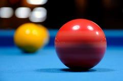 Billiard Balls. Spinning red ball on blue billiard table Royalty Free Stock Photos