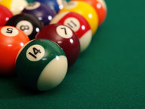 Billiard balls. Macro photo of a pool table and billiard balls with space for copy. Shallow depth of field with focus on the fourteen ball royalty free stock photos