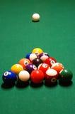 Billiard Balls. A pyramid of billiard balls racked up on a pool table royalty free stock image