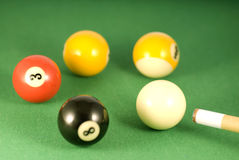 Billiard balls. Five  balls on a pool table Royalty Free Stock Photo