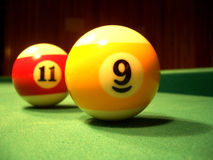 Billiard balls - 9th & 11th stock images