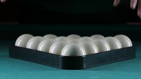 Billiard balls arranged in a triangle. Green table stock video footage
