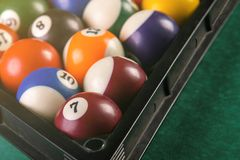 Billiard balls arranged in a triangle viewed from above. royalty free stock photo