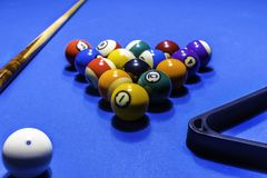 Billiard balls. With cue on blue table Stock Photography