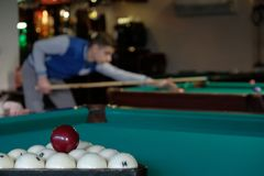 Billiard balls on a billiard table background stock photos