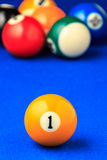 Billiard balls in a blue pool table. Royalty Free Stock Image