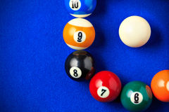 Billiard balls in a blue pool table. Stock Photo