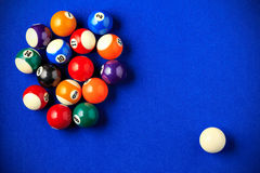 Billiard balls in a blue pool table. Horizontal image viewed from above Royalty Free Stock Image