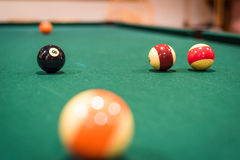 Billiard Balls. A closup of several billiard balls, with the background balls out of focus Royalty Free Stock Image