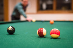Billiard Balls. A closup of several billiard balls, with the player and background balls out of focus Royalty Free Stock Images