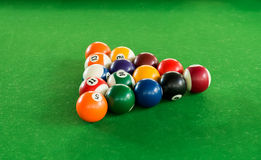 Billiard balls composition on green pool table Stock Images