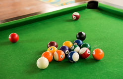 Billiard balls composition on green pool table Royalty Free Stock Photos