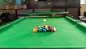 Billiard balls composition on green pool table Stock Photo