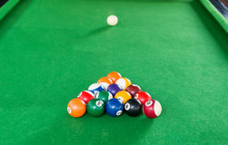 Billiard balls composition on green pool table Stock Photos