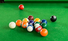 Billiard balls composition on green pool table Royalty Free Stock Photography