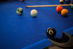 Billiard balls composition on pool table Royalty Free Stock Photo