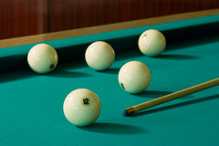Billiard-balls and cue Stock Image