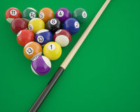 Billiard balls with cue on a green table Royalty Free Stock Photography