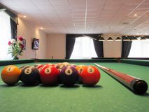 Billiard balls with cue in the room royalty free stock images