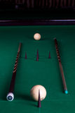 Billiard balls and cues Stock Images