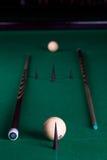 Billiard balls and cues Stock Photo