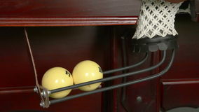 Billiard balls falling in a billiard pocket. stock video footage