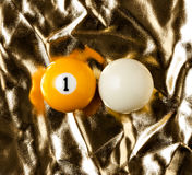 Billiard balls on golden surface. Stock Images