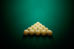 Billiard balls on green baize in the game of pyramid Royalty Free Stock Image