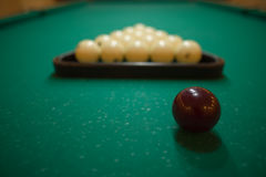 Billiard balls on green baize in the game of pyramid Royalty Free Stock Images