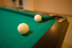 Billiard balls on green baize in the game of pyramid Royalty Free Stock Photos