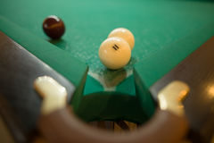 Billiard balls on green baize in the game of pyramid Stock Photos