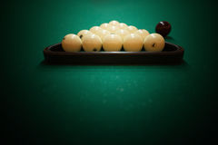 Billiard balls on green baize in the game of pyramid Royalty Free Stock Photo