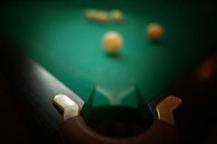 Billiard balls on green baize in the game of pyramid Stock Photography