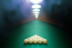 Billiard balls on green baize in the game of pyramid Stock Photo