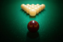 Billiard balls on green baize in the game of pyramid Stock Image