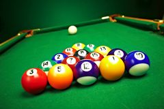 Billiard balls on green cloth Royalty Free Stock Image
