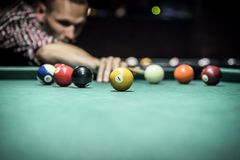 Billiard. Balls in a green pool table Stock Image