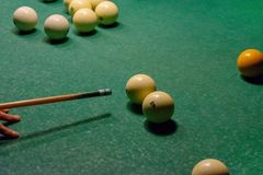 Billiard balls on a green pool table stock image