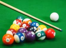 Billiard balls in a green pool table Stock Image